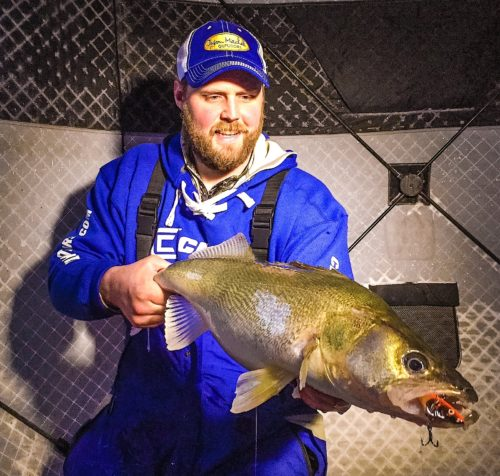 Lake Winnipeg guide Jason Hamilton with a greenback walleye that choked on a Salmo Zipper.